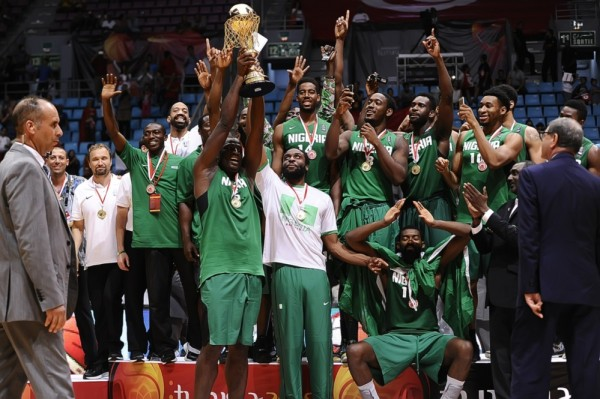 Nigeria's Senior Basketball Team Celebrate Their Victory at the 2015 Afrobasket Tournament. Image: FIBA.