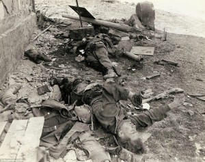 Last fight: Three dead German Waffen-SS Troops lay on the ground after trying to stop an advance of an American armored column