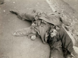 Gruesome: The bodies of two German soldiers lie on together in a gutter in France