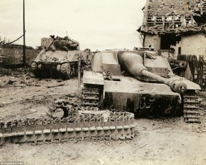 Out of action: A knocked-out American tank sits beside a similarly wrecked German tank on a street on the Western Front
