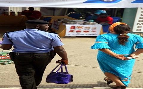 policeman-carrying-bag