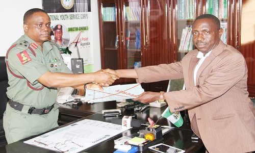PIC. 22. DIRECTOR-GENERAL, NATIONAL YOUTH SERVICE CORPS (NYSC),   BRIG.-GEN. JOHNSON OLAWUMI (L), RECEIVING THE NAMES OF  NOMINEES RECOMMENDED FOR THE 2015 NYSC HONOURS AWARD FROM THE  CHAIRMAN OF THE NATIONAL SELECTION COMMITEE, DR KEVIN IHENETU,  IN ABUJA ON WEDNESDAY (14/10/15). 7256/14/10/2015/KRY/CH/BJO/NAN