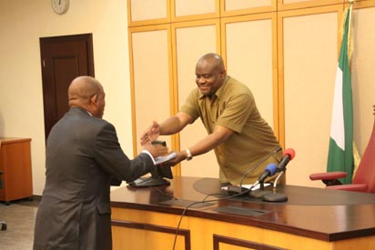 Omereji submits the commission's report to Governor Wike