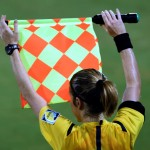 NANJING, CHINA - AUGUST 23: A FIFA Assistant Referee in action during the 2014 FIFA Girls Summer Youth Olympic Football Tournament Semi Final match between Venezuela and Mexico at Wutaishan Stadium on August 23, 2014 in Nanjing, China.  (Photo by Stanley Chou - FIFA/FIFA via Getty Images)