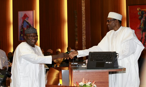 Nigeria's new minister of Solid Minerals, Kayode Fayemi, is congratulated by President Muhammadu Buhari after taking an oath of office during a swearing-in ceremony in Abuja