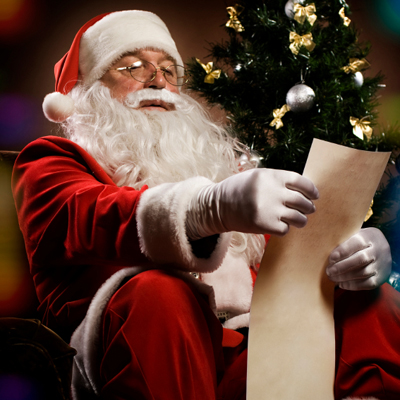 Traditional Santa Claus reading a letter