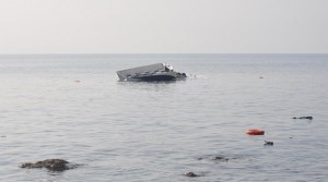 CANAKKALE, TURKEY - JANUARY 30: A boat, which was carrying refugees, is seen in the Aegean sea after it sank off close to coast of Ayvacik district, Canakkale, Turkey on January 30, 2016. At least 33 people, have drowned off the Aegean Sea coast of Turkey (Photo by Mehmet Yavas/Anadolu Agency/Getty Images)