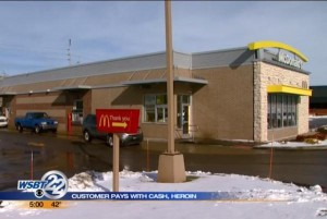 McDonalds-customer-pays-at-drive-through-with-cash-heroin