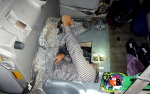 This Tuesday, March 1, 2016, photo provided by the U.S. Customs and Border Protection shows a Brazilian man hidden inside a 2001 Toyota Sequoia gas tank. Customs and Border Protection says inspectors found the 38-year-old inside the modified tank of the vehicle early Tuesday at a crossing in Calexico, Calif. An imaging device spotted anomalies in the SUV's gas tank and backseats.(U.S. Customs and Border Protection via AP)