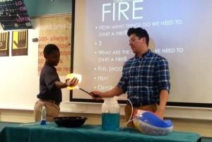 Science-teacher-lights-boys-hand-on-fire-in-methane-demonstration