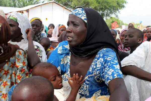 A woman who was rescued after being held captive by Boko Haram, attends to her baby at an internally displaced person's camp near Mubi, northeast Nigeria October 29, 2015. REUTERS/Stringer