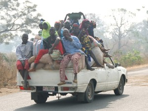 truck-overloaded-with-people-300x225