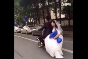 Husband-of-the-year-fails-to-notice-brides-fall-from-back-of-electric-scooter