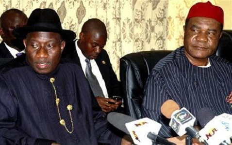 Nigeria's acting president Goodluck Jonathan sits with Vincent Ogbulafor, chairman of the ruling People's Democratic Party, at a meeting in the capital Abuja