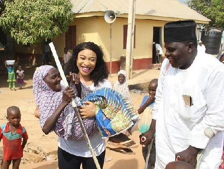 Tonto Dikeh Cuddles Elderly Disabled Woman As Her Foundation Celebrates World Disability Day
