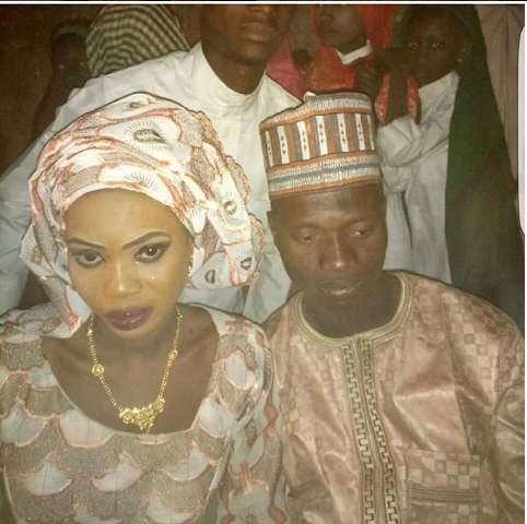 This Photo of Nigerian Man and his New Bride is Currently Buzzing the Internet, Do You See it?