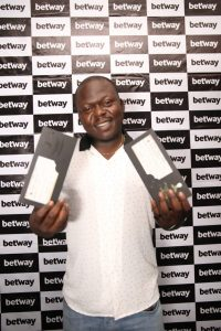 Winner Adebesin Awokoya with tickets 2 e1529613502839 200x300 - Betway Rewards Buyer with All-Expense Paid Journey to Watch Nigeria in Russia