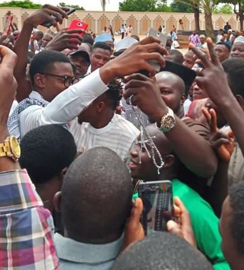 Football fans mob Ahmed Musa