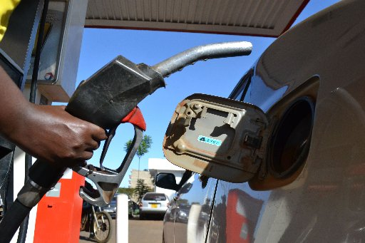 File.photo of a motorist buying fuel