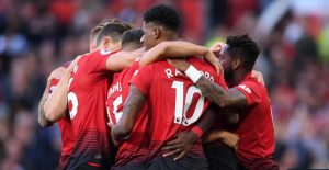 Manchester United players celebrating a goal