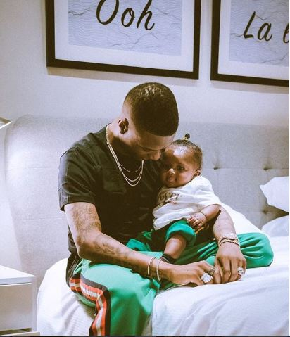 wizkid gifts son zion a customized diamond neck piece - Wizkid Celebrates As His Son, Zion Clocks 2