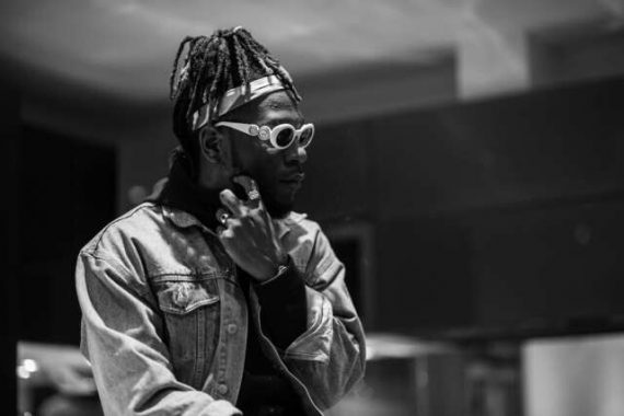 Burna Boy apologizes for kicking fan