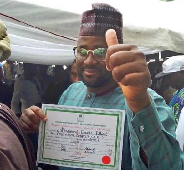 Actor Desmond Elliot receives his certificate of return to Lagos State House of Assembly from INEC