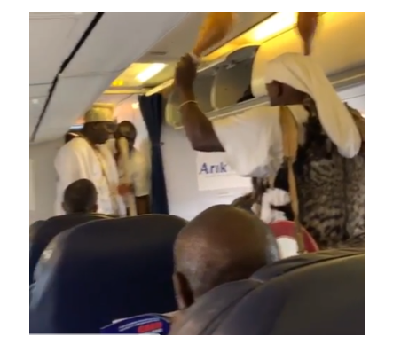 VIDEO: 'Blood of Jesus' - Nigerians prays as Oni Of Ife's diviner perform rites aboard a plane
