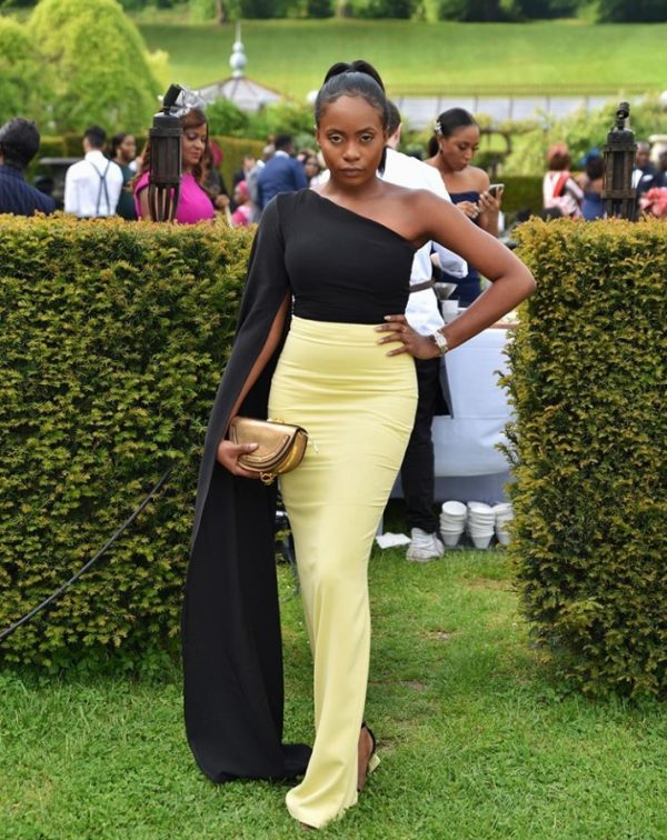 """20190523 143130 600x756 - """"How you show up to your cousin's wedding"""" – Kiki Osibanjo Steps Out In Black and Yellow Tailored Outfit"""