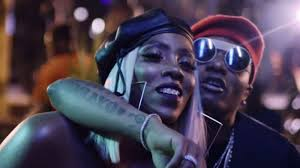 [Watch Video]: Wizkid playfully slaps Tiwa Savage On the Butt