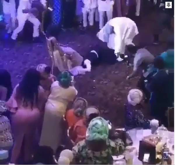 [Video]: Watch a Nigerian father drag his daughter's husband off as he made to remove her garter