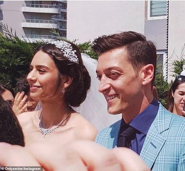 [Photos]: Arsenal star Mesut Ozil ties the knot with 2014 Miss Turkey Amine Gulse