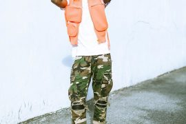 [PHOTO]: Wizkid Wears Loius Vuitton Rubber Utility Gilet Jacket Worth1million Naira