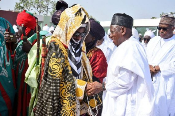 Photos: Ganduje and Sanusi shake hands on Eid day
