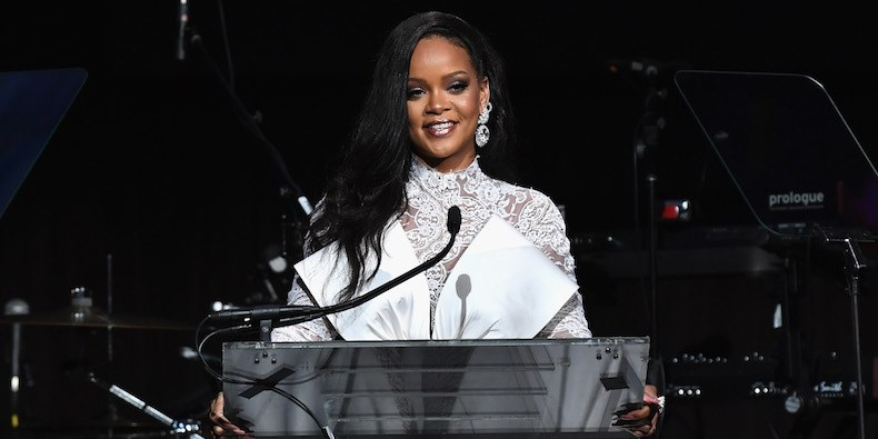 Rihanna - American Singer, Rihanna Rocks Mint Cleavage-Baring Outfit (Photo)