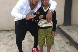 [PHOTOS]: Charles Okocha Steps Out With Son After His Successful Surgery