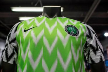 [PHOTO]: Man Spotted On A Bike Donning An Ankara Version Of The Super Eagles Jersey