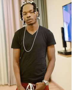 Naira Marley Replies A Fan Who Accused Him Of Repeating A Shirt