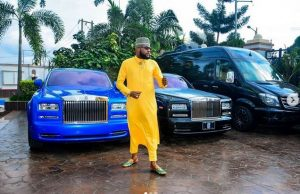 photo 1 300x194 - [PHOTOS]: Five Star Music Boss, E-Money Poses With His Luxurious Cars