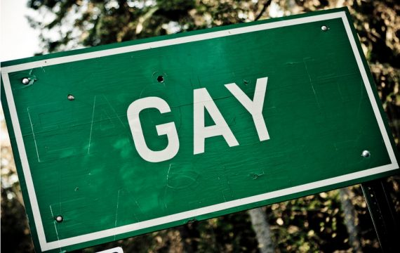 A sign with the letters spelling GAY