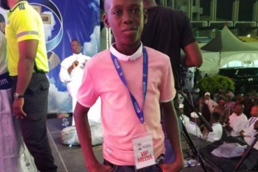 Viral Orange Seller With Angelic Voice Performs On Stage In Lagos