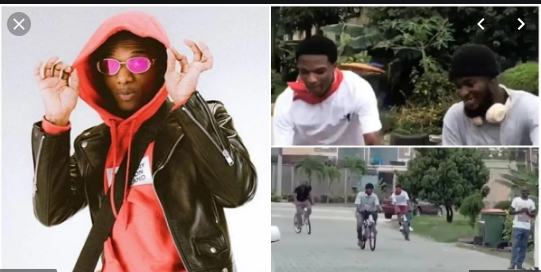 Wizkid riding bicycle with friends