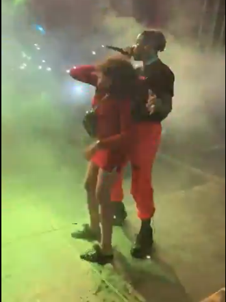 rema rocking a girl on stage