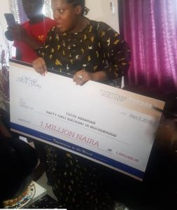 Toyin Abraham while receiving the gift
