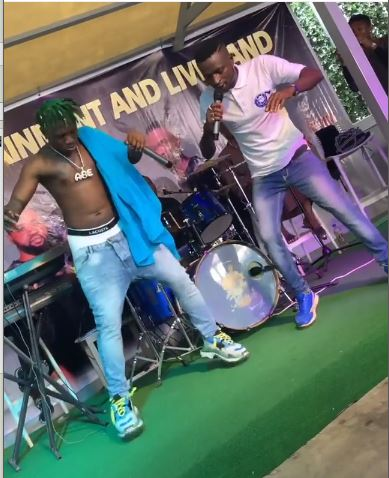 Zlatan Ibile and a band member