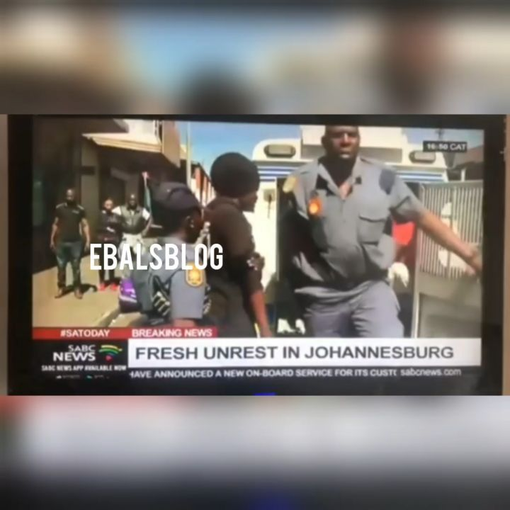 South African Officers arresting protesters for looting