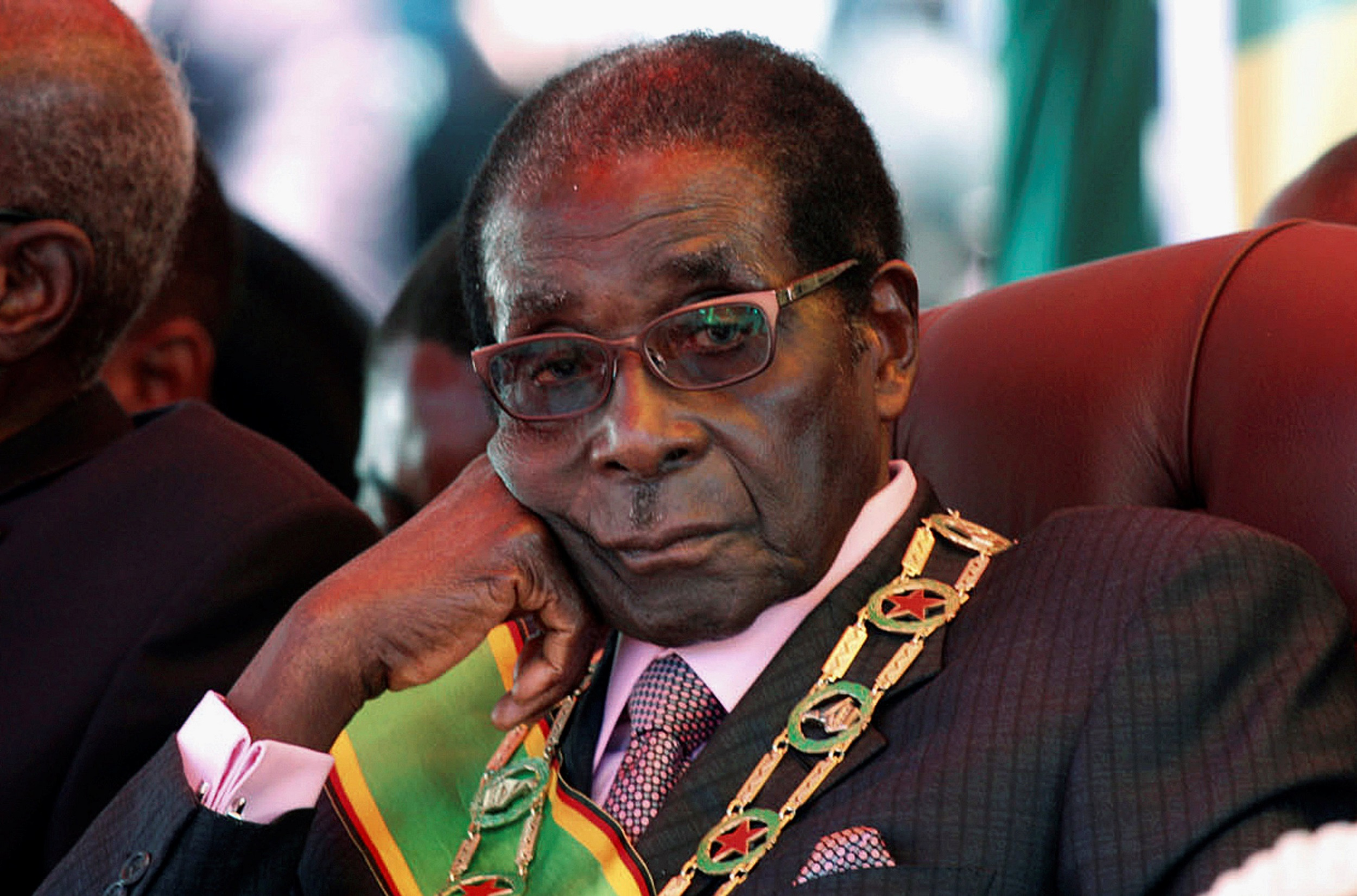 Relatives, officials attend mass for Mugabe in Singapore