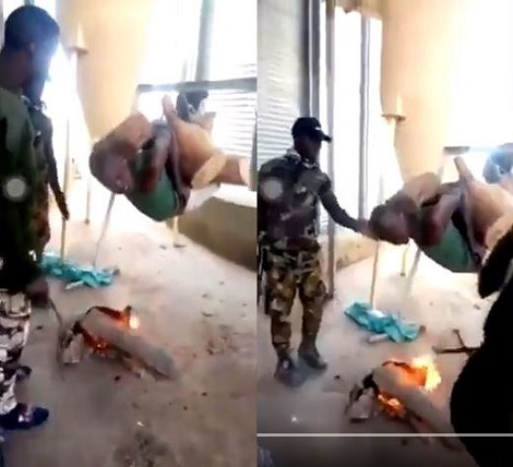Nigerian soldiers roasting a man