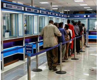File photo of customers at a bank