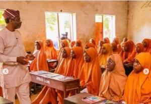 Femi Gbajabiamila teaching in a school